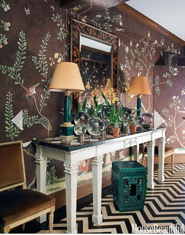 Accessorize any foyer with brilliance by showcasing emerald green lamps and chocolate browns as seen here.