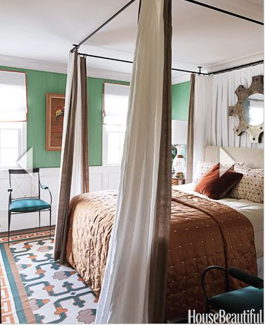 Bedroom wall compels interest with this Emerald Green papered wall.